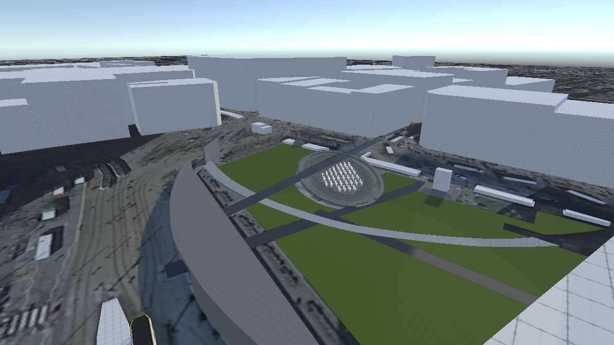 An in-engine screenshot of an overview of Picadilly Gardens. Most buildings as placeholder blocks for now.